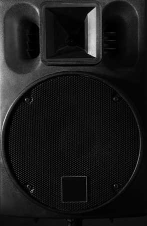 Big loudspeaker on black background, close up