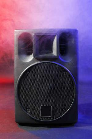 Black loudspeaker in a smoke on dark background Stock Photo