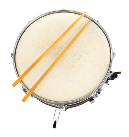 Red drum with drum sticks isolated on white background, close up Stock Photo