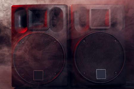 Big black loudspeakers in a smoke, close up