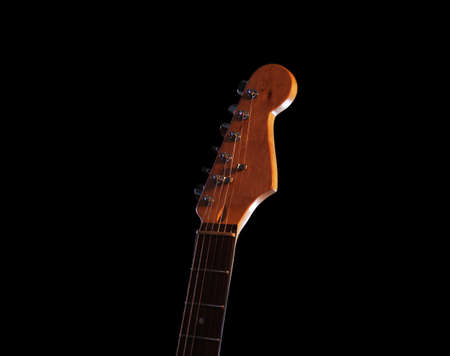 Guitars fingerboard on dark background, close up Stock Photo