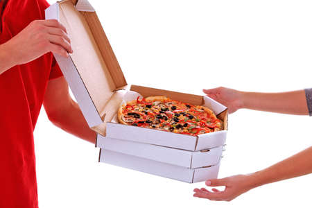 Delivery boy with cardboard pizza boxes isolated on white Stock Photo