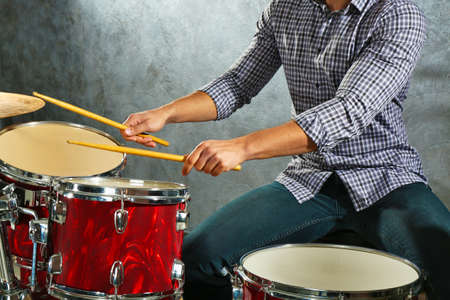 Musician playing the drums in a studio