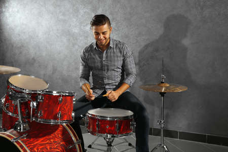 Musician playing the drums in a studio Stock Photo - 94852775