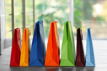 Colourful paper shopping bags on defocused background Archivio Fotografico