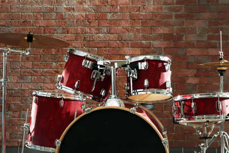 Drum set on brick wall background Stock Photo