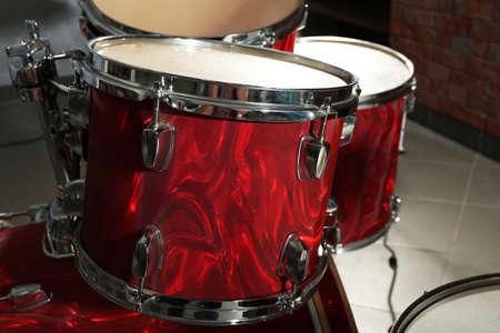 Drum set on brick wall background Stock Photo
