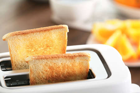 Served table for breakfast with toast and fruit, close-up