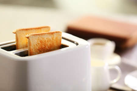 Served table for breakfast with toast and coffee, on blurred background Foto de archivo