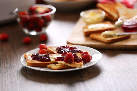 Served table for breakfast with toast and jam, close-up Stock Photo