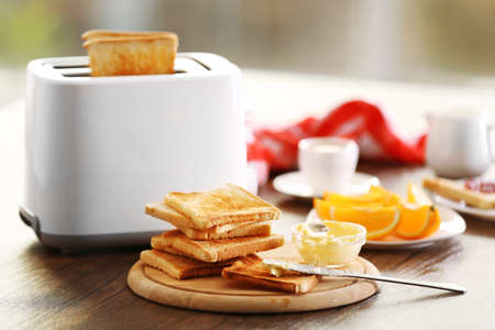 Served table for breakfast with toast and coffee, on blurred background Stock Photo