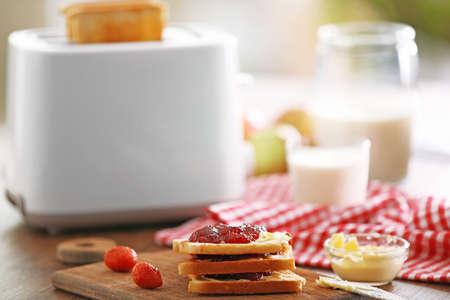 Served table for breakfast with toast, milk and jam, close-up Foto de archivo