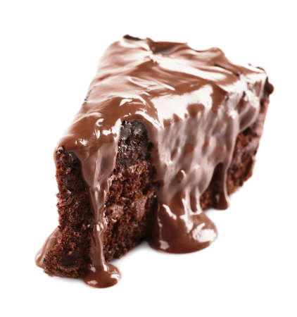 Chocolate poured on a piece of cake isolated on white