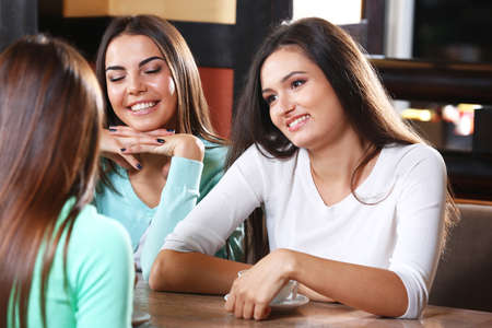 Attractive girls resting in cafe Stock Photo