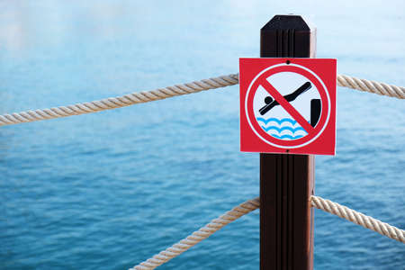 No Diving warning sign in front of pier