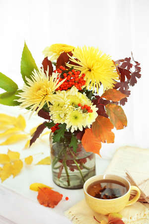 Beautiful autumn bouquet with chrysanthemums flowers, on windowsill Stock Photo
