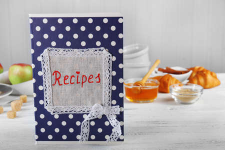 Recipe book on a table with ingredients for baking Stock Photo