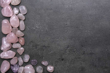 Frame of pink quartz on grey background, copy space Stock Photo