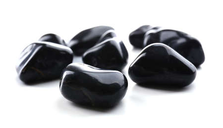 Black onyx pile isolated on white background