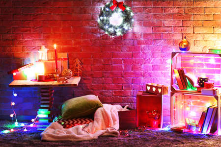 Christmas decor in a room on a brick wall background