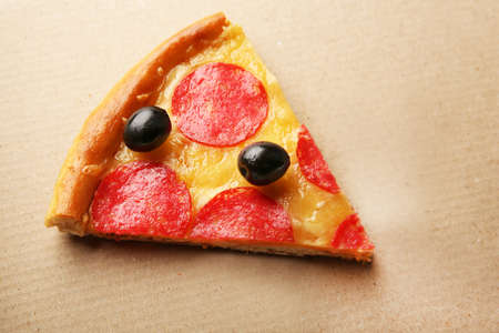 Delicious tasty piece of pizza  on cardboard box Stock Photo