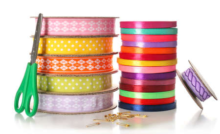 Spools of color ribbon and scissors, isolated on white