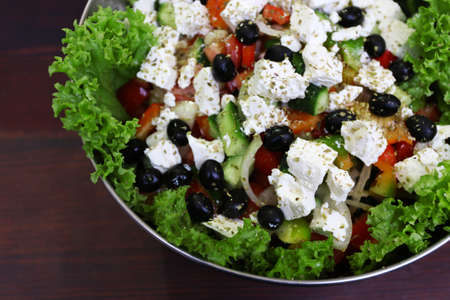 Greek salad in bowl on a table Stock Photo