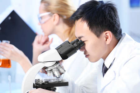 Young medical technicians working in laboratory Stock Photo