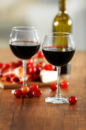Two wineglasses with grape on the table