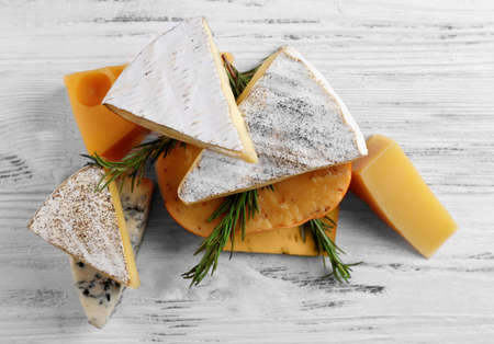 Different kinds of cheese on white wooden background, close up Stock Photo