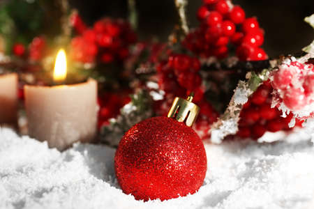 Burning candles and rowan with snow on wooden background, closeup Stock Photo