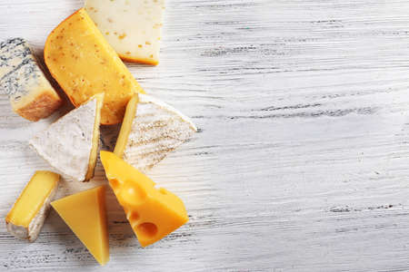 Different kinds of cheese on white wooden background, copy space Stock Photo