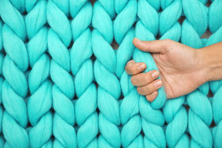 Hand on Knitted woolen background Stock Photo