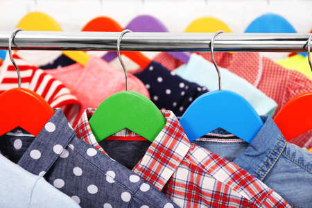 Clothes for children on hangers closeup