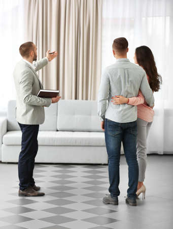 Happy family with estate agent,  in new home