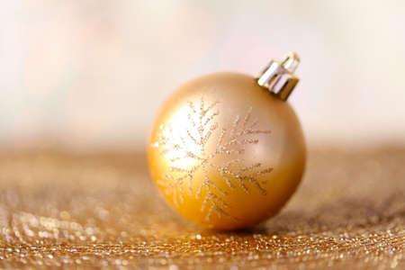 Christmas ball on abstract shiny background Stock Photo