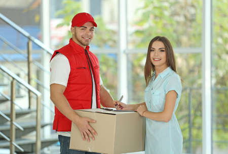Young woman and courier - delivery concept Stock Photo