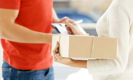 Woman signing receipt of delivery package, close up Banque d'images