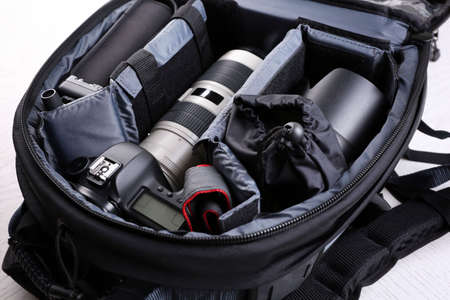 Photographer's equipment on a light background