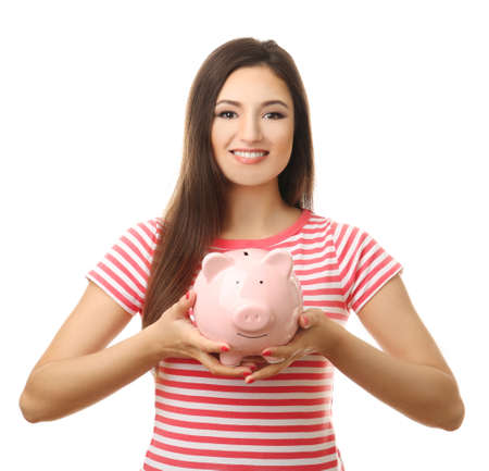 Woman with pig money box isolated on white