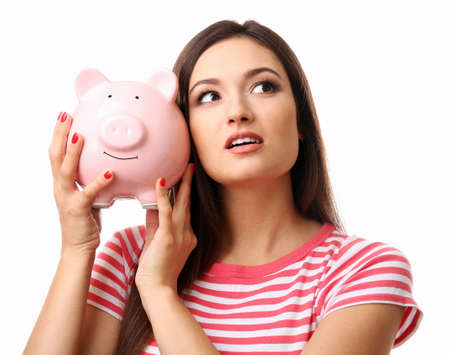 Woman with pig money box and banknotes isolated on white