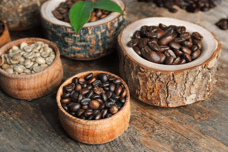 Collection of coffee beans on old wooden table, close up Stock Photo