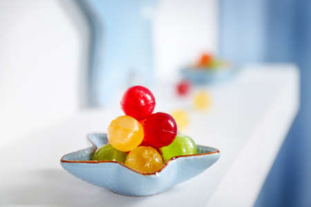 Plate with sweets on a shelf closeup Stock Photo