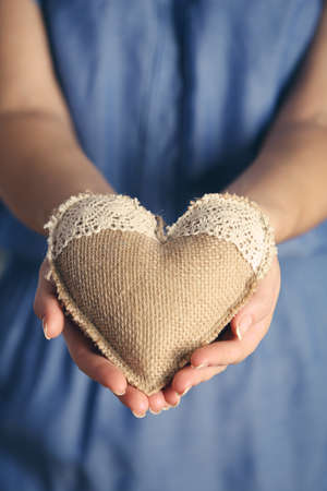 Closeup of craft heart in female hands Stock Photo