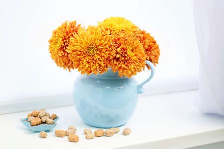 Jar with flowers on a windowsill Stock Photo
