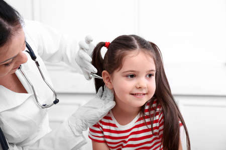 Doctor examining child's ears Stock Photo