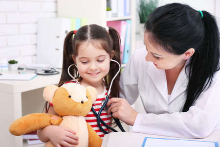 Doctor examining child in the office