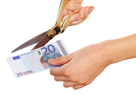 Hands with scissors cutting Euro banknote, isolated on white Stock Photo