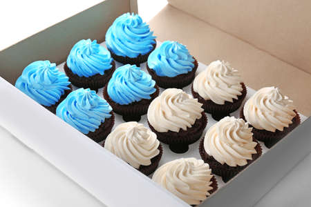 Tasty cupcakes in paper box, close up