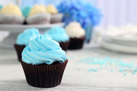 Cupcakes on wooden table Stock Photo
